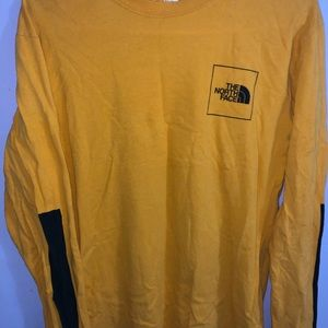 The North Face, yellow long sleeve t-shirt.